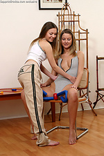 Two chicks strip and finger on kitchen chair