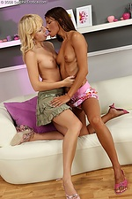 Alluring beauties tongue and rub on sofa