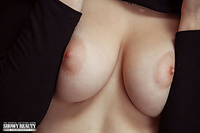 Seductive busty and nature art photo