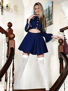 Eva jude eva jude posing in her royal blue long sleeves and matching skirt, with white thigh high stockings