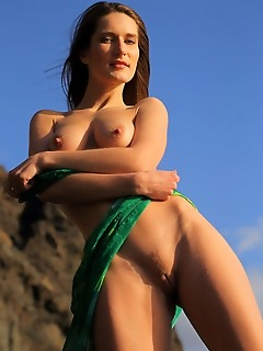 Elina elina poses on the rocky terrain baring her erect nipples and delectable pussy.