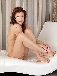 Cute redhead with fresh, innocent appeal and nubile body.