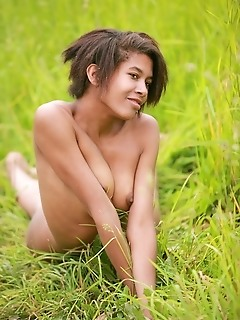 Dark-skinned babe with exotic looks and nubile physique.