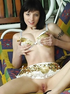 Petite, raven-haired cutie with tight, nubile physique.