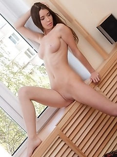 Natural and uninhibited brunette with sunny personality and slender figure.