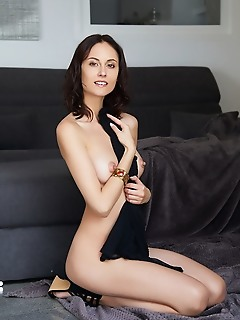 Sade mare sade mare strips on the floor as she displays her perky tits and slender body.