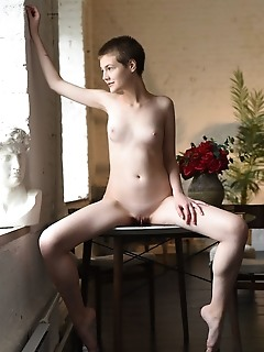 Jerricka newcomer jerricka strips on the table baring her nubile body.
