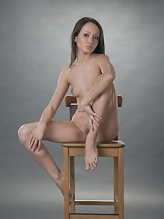 Elegant model with exotic looks and petite charms.