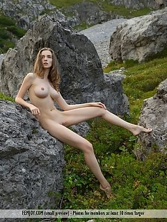 Irina j plays naked in bed showing off every part of her perfect body.