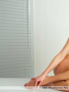 Long-legged sweetheart lorena b sprawled naked on the carpet, showing off her svelte limbs, firm ass, and shaved pussy