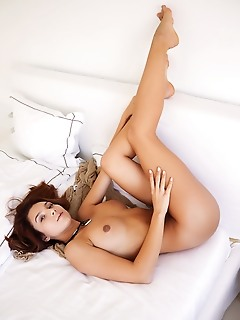 Belka top model belka bares her delectable titties and sweet pussy on the bed.