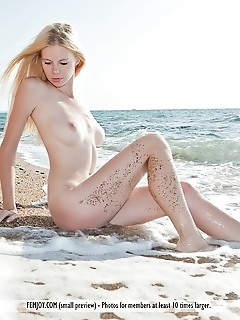 so adorable lily c. Starts of in her so adorable black polka-dotted bikini. She is on a sandy beach, with the ocean waves lapping at her feet. She tak