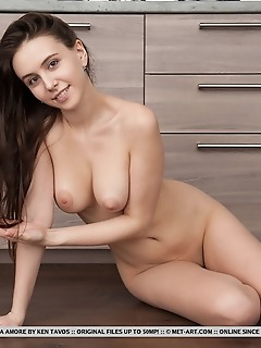 Alisa amore top model alisa amore flaunts her delectable body in the kitchen.