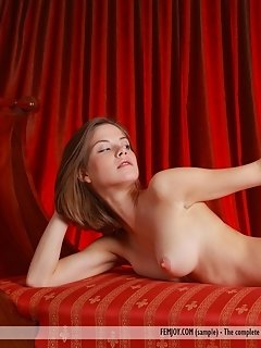 Edwige a strips off her dress as poses sensually on top of the table.