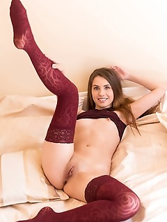 Ella rose newcomer ella rose flaunts her sexy, red stockings and meaty pussy on the bed.