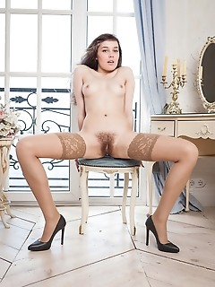 Ulia ulia spreads her wide open baring her hairy pussy on the chair.