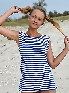 Calli in her striped beach dress and matching pigtails, calli shows off her fun and playful appeal in a beach photo shoot