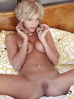 Stunning debutante in full, erotic poses on the bed.