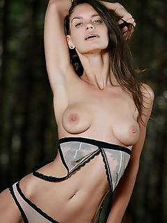 Yasmina yasmina poses seductively for the camera wearing matching lace brassiere and panties