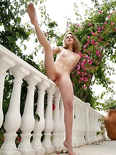 Clarice clarice flaunts her naked body and pink pussy in the balcony.