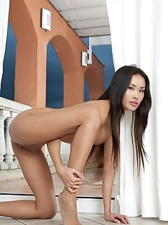 Exotic asian model with delectable brown assets and athletic build.