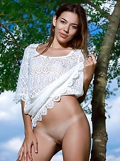 Maddison maddison flaunts her tight body and shaved pussy as she poses on the grassy field.