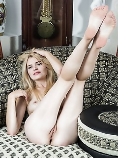 Madlen newcomer madlen bares her creamy, white body with pink pussy as she poses   on the couch.