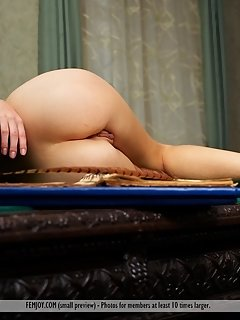 Top 10 model lily c, confidently flaunts her smoking hot body as she enjoys baring her delectable assets on the table.