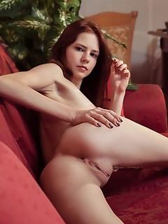 Juliett lea juliett lea spreads her legs wide open baring her pink pussy on the sofa.