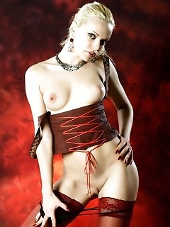 Curvy body with fair skin in ultra sexy red lingerie and sheer stockings.