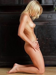 Carinela shows off her naked, slender body with round ass, sexy legs and yummy pussy as playfully poses on the couch.