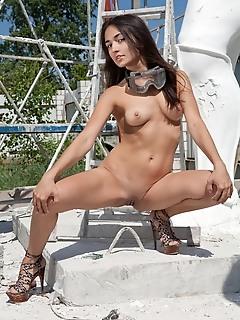 Soft feminine curves on a petite well-sculpt body.