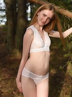 Blonde girl in white