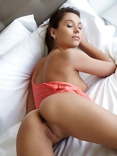 Sabrisse a sabrisse a strips on the bed as she flaunts her tight ass and sweet pussy.