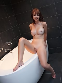 Carlina bares her luscious body as she stretch her legs wide open baring her pink pussy on the sofa.