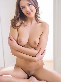 Onorin strips off her lingerie and bares her scrumptiously puffy breasts, firm ass, and shaved snatch.