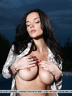 Raven-haired vixen with sultry gaze, large tits and shapely physique.