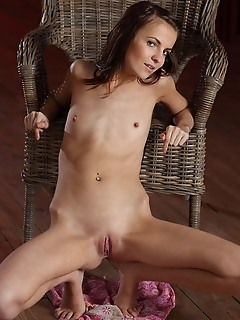 Naughty petite with nubile physique and perky, tight details.