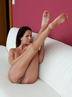 Roberta bertis slender naked body sprawled on sofa, with a breathtaking view of her sweet and ripe pussy, long, smooth legs, and beautiful puffy breas