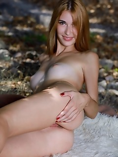 Aileen aileen strips outdoors, baring her tanned body and shaved pussy.
