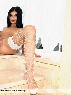 Wearing a matching white lingerie, maryana can