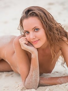Patrizia poses delightfully with a sweet, coy smile and a fun, engaging personality.