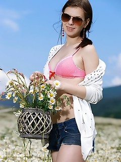 Karolina young karolina young delightfully poses among the flowery field as she bares her amazing body   with delectable tits.