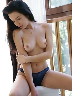 Aurelia perez aurelia perez strips her sexy lingerie baring her shaved cunt.