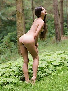 With her sensual and tempting poses that compliments her ultra-feminine body, candice sprawls and flaunts all over the grass outdoors.