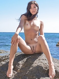 Seaside tiny erotic girls posing