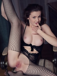Emily bloom wearing a black lace suit and fishnet hosiery, emily bloom exudes playful and naughty sizzler as she flaunts her gorgeous body into a vari