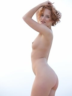 Edwige confidently strips and poses in front of the camera and flaunts her naked, nubile body.