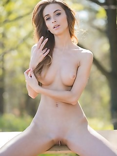 Cara mell cara mell shows off her long and lean physique, slender limbs, and smooth assets as she poses in a wooden swing