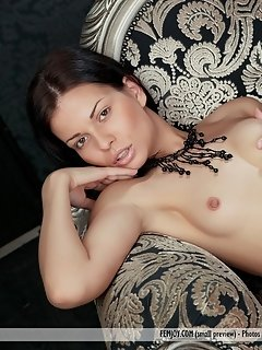 Milagres makes a truly sizzling experience as she strips her jeans with her cowboy hat besides the slot machine.